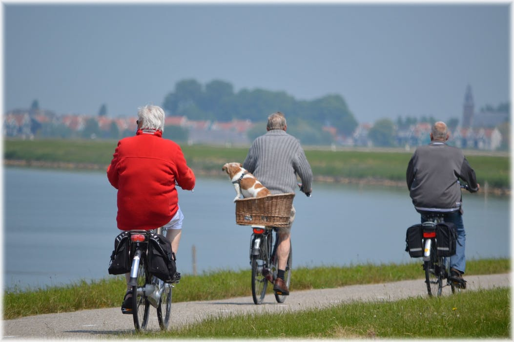 Old people riding bikes