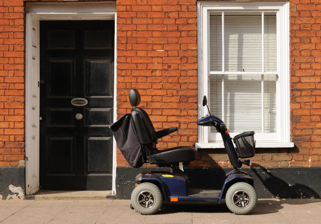 Mobility scooter infront of house